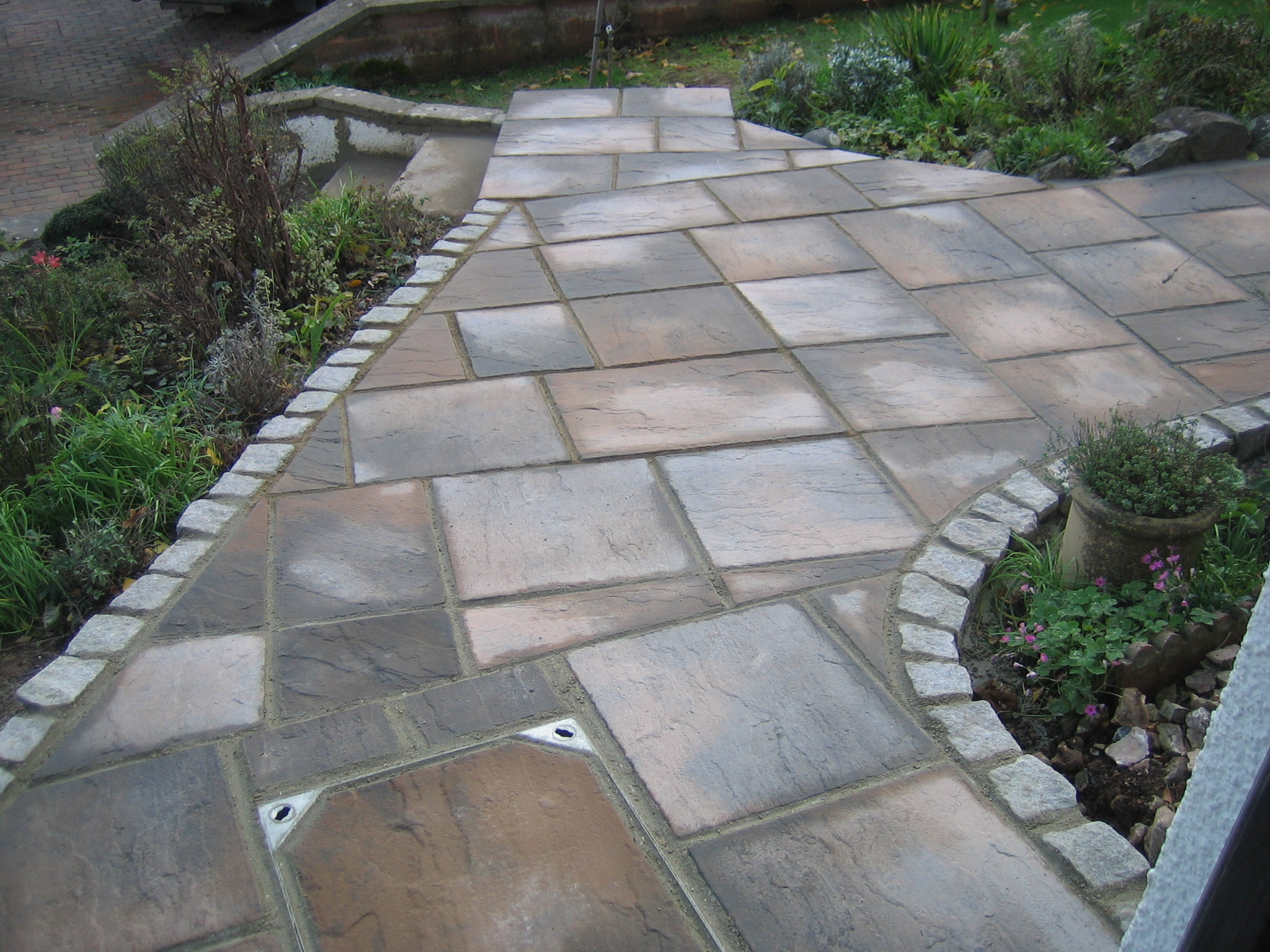 Exeter price beating supply laying service across devon - How to lay pebbles in garden ...